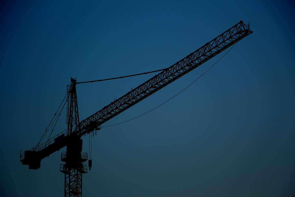 Crane with blue sky background